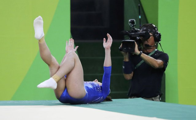 2016 Rio Olympics, Artistic Gymnastics, Final, Women's Individual All-Around Final, Rio Olympic Arena, Rio de Janeiro, Brazil on August 11, 2016. Seda Tutkhalian (RUS) of Russia falls out of bounds during her floor routine at the women's individual all-around final. (Photo by Mike Blake/Reuters)