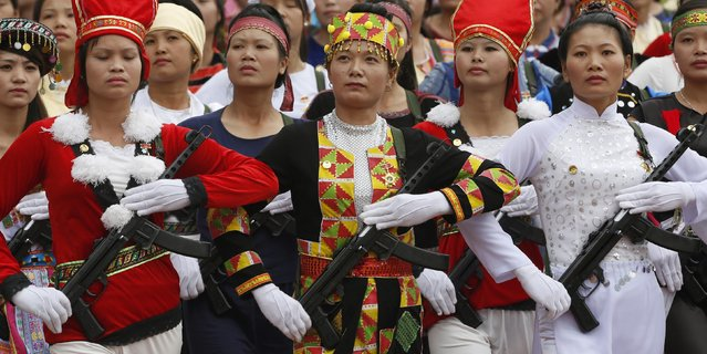 Vietnamese female militants, dressed in ethnic minorities costumes, hold rifles while marching during the 60th anniversary celebrations of the Dien Bien Phu battle in the historic city May 7, 2014. (Photo by Reuters/Kham)