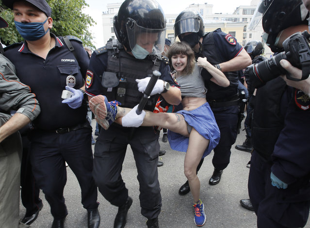 Police detain a woman protesting against the court verdict for Yuliy Boyarshinov, and Viktor Filinkov, members of a left-wing group Set (Network) at the Western regional military court in St.Petersburg, Russia, Monday, June 22, 2020. (Photo by Dmitri Lovetsky/AP Photo)