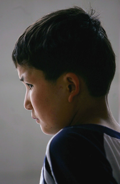 Maimaiti Aili, a 13-year old boy from China's Xinjiang Uygur Autonomous Region, is seen at an assistance center February 24, 2005 in Shenzhen, Guangdong Province, China. (Photo by Cancan Chu/Getty Images)