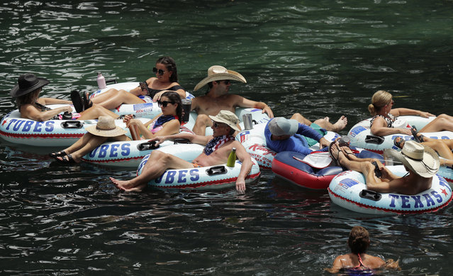 """Tubers float the Comal River despite the recent spike in COVID-19 cases, Thursday, June 25, 2020, in New Braunfels, Texas. Texas Gov. Greg Abbott said Wednesday that the state is facing a """"massive outbreak"""" in the coronavirus pandemic and that some new local restrictions may be needed to protect hospital space for new patients. (Photo by Eric Gay/AP Photo)"""