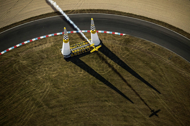 A handout image released by Global Newsroom on 04 September 2016 shows Nigel Lamb of Great Britain performs during the qualifying at the sixth stage of the Red Bull Air Race World Championship at Eurospeedway in Lausitz, Germany, 03 September 2016. (Photo by Joerg Mitter/EPA)