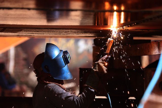 A worker welding at a ship breaking yard at Keraniganj, Dhaka District, Bangladesh during the coronavirus crisis on June 30, 2020. Following the relaxation of covid-19 restrictions, labourers in the ship breaking and building industry of Bangladesh opt to resume work with hopes of securing financial stability after being left with almost no work, leading to extreme financial crisis. (Photo by Md Manik/SOPA Images/LightRocket via Getty Images)