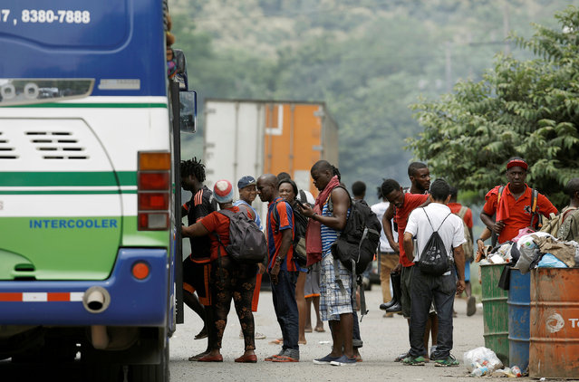African migrants stranded in Costa Rica board a bus at the border between Costa Rica and Nicaragua, in Penas Blancas, Costa Rica, September 8, 2016. (Photo by Juan Carlos Ulate/Reuters)