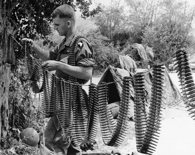 Pfc. Johnny Albritton of Farmerville, La., a machine-gunner with the 101st Airborne Division, strings out his ammunition to dry following a heavy thundershower, October 2, 1967 at Chu Lai, Vietnam, where he is stationed as a member of the 2nd Platoon, C Company, 2nd Bn. (Abn), 327th Infantry. (Photo by AP Photo)