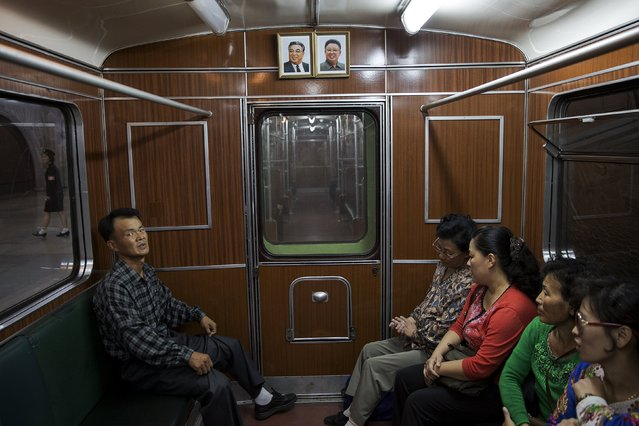 Passengers sit inside a train that stopped at a subway station visited by foreign reporters during a government organised tour in Pyongyang, North Korea October 9, 2015. (Photo by Damir Sagolj/Reuters)
