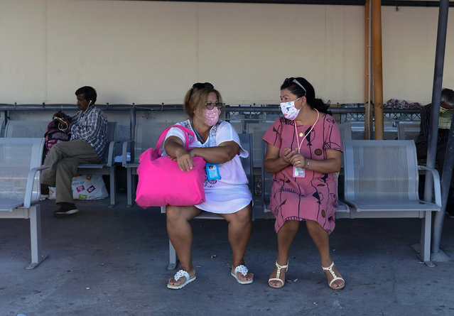 Two women wearing face masks to protect against the spread of the new coronavirus, sit on a bench at the port of Piraeus, near Athens, Sunday, August 30, 2020 Greek health officials said Friday that they are expanding for another two weeks a series of domestic health measures, including the obligatory use of masks in most indoors public areas, distancing on beaches and a ban on large gatherings on the occasion of religious festivals. (Photo by Michael Varaklas/AP Photo)