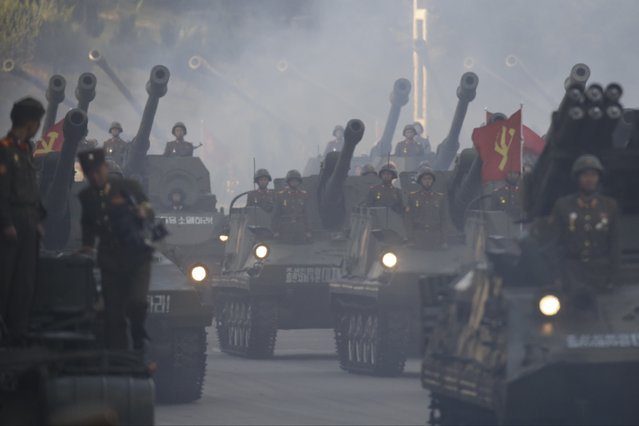 North Korean soldiers on tanks parade in Pyongyang, North Korea, Saturday, October 10, 2015. (Photo by Wong Maye-E/AP Photo)
