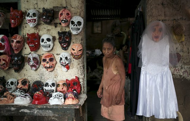 A woman sells masks for the Los Aguizotes festival in the indigenous community of Monimbo in Masaya, Nicaragua, October 16, 2015. (Photo by Oswaldo Rivas/Reuters)