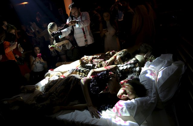 Models lay on a bed as they present creations from the Ronaldo Fraga Winter 2016 collection as spectators takes pictures of them during Sao Paulo Fashion Week October 19, 2015. (Photo by Nacho Doce/Reuters)