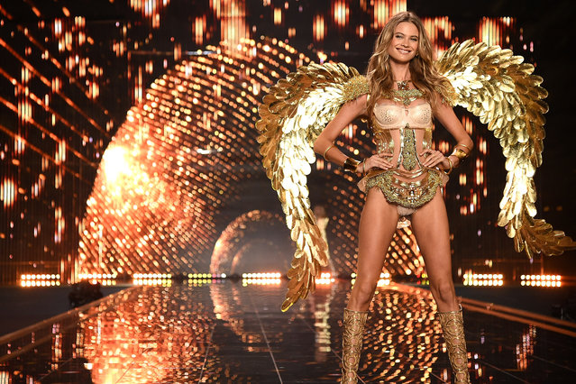 Victoria's Secret model Behati Prinsloo walks the runway during the 2014 Victoria's Secret Fashion Show at Earl's Court exhibition centre on December 2, 2014 in London, England. (Photo by Dimitrios Kambouris/Getty Images for Victoria's Secret)