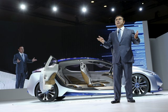 Carlos Ghosn, CEO of the Renault-Nissan Alliance presents the Nissan IDS concept car at the 44th Tokyo Motor Show in Tokyo October 28, 2015. (Photo by Thomas Peter/Reuters)