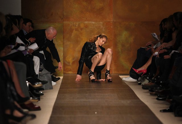 A model slips and falls while presenting a creation from the Herve Ledger by Max Azria Fall 2009 collection during New York Fashion Week February 15, 2009. (Photo by Eric Thayer/Reuters)