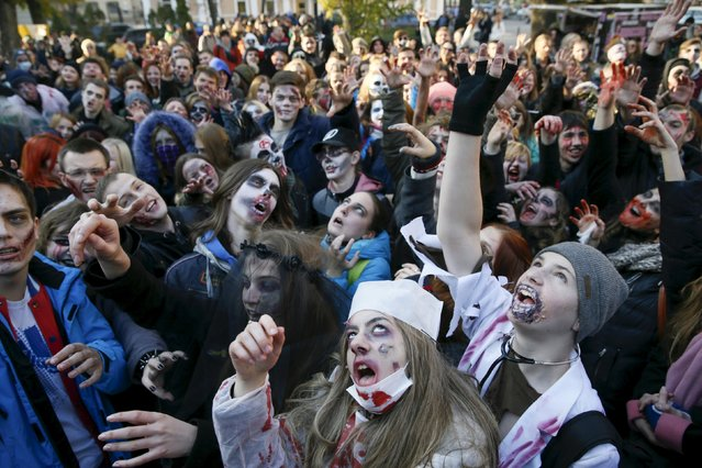Revellers take part in a zombie parade to celebrate Halloween in Kiev, Ukraine, October 31, 2015. (Photo by Valentyn Ogirenko/Reuters)