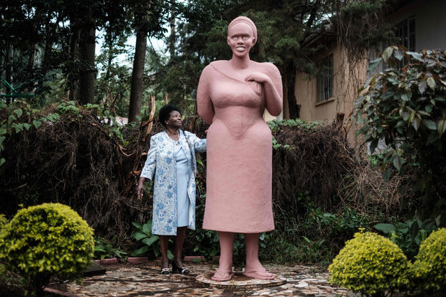 Hannah Njenga, 80, the wife of Kenyan sculptor Edward Njengais, stands next to his stoneware work titled Mama Ngina at their home in Nairobi on March 12, 2018. Njenga is the one of East Africa's prominent sculptors who has been capturing scenes from Kenya' s dailylife mainly as miniature figures. (Photo by Yasuyoshi Chiba/AFP Photo)