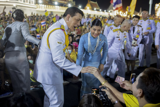 King Maha Vajiralongkorn, center left and and Princess Sirivannavari Nariratana, center right, greet supporters in Bangkok, Thailand, Sunday, November 1, 2020. Under increasing pressure from protesters demanding reforms to the monarchy, Thailand's king and queen met Sunday with thousands of adoring supporters in Bangkok, mixing with citizens in the street after attending a religious ceremony inside the Grand Palace. (Photo by Wason Wanichakorn/AP Photo)