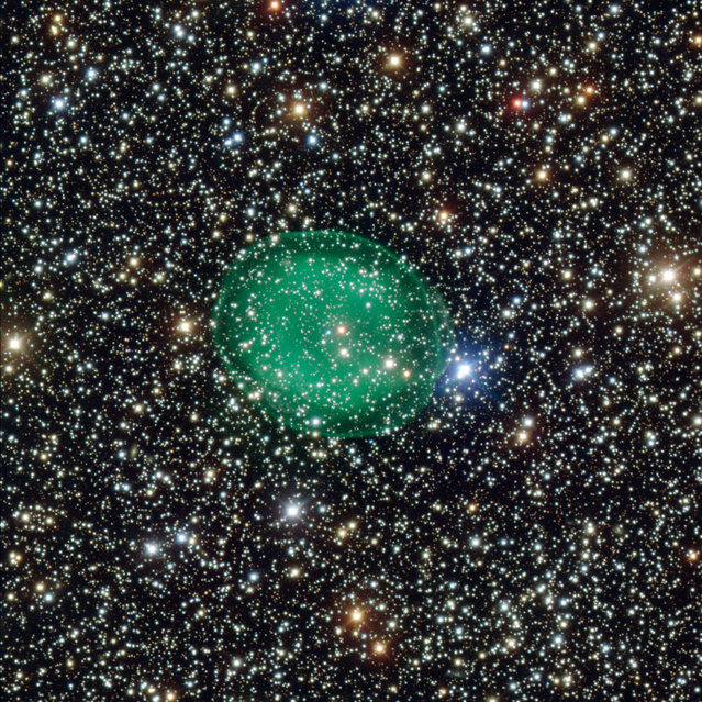 """This intriguing picture from ESO's Very Large Telescope shows the glowing green planetary nebula IC 1295 surrounding a dim and dying star. It is located about 3,300 light-years away in the constellation of Scutum (The Shield). The new image, released on April 10, 2013 by the European Southern Observatory, shows the planetary nebula IC 1295 like it has never been seen before. This picture, which ESO scientists dubbed """"ghostly"""", marks the first time the nebula has been imaged such unprecedented detail. (Photo by ESO)"""