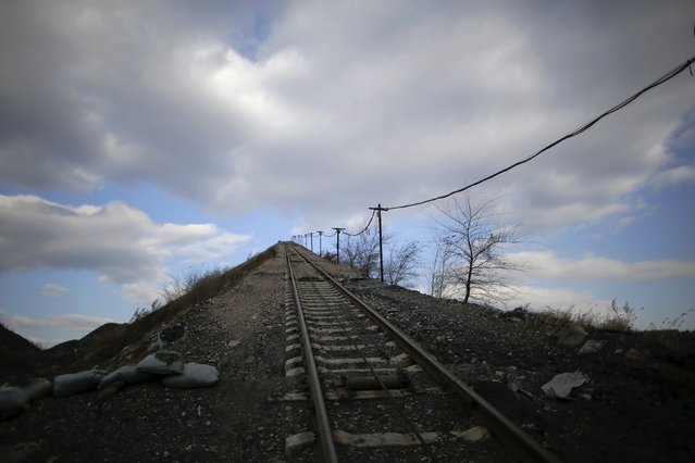 A railway track for carrying coal gangue, also known as coal waste, leads onto the top of the gangue hill from the exit of a coal mine of the state-owned Longmay Group on the outskirts of Jixi, in Heilongjiang province, China, October 24, 2015. (Photo by Jason Lee/Reuters)