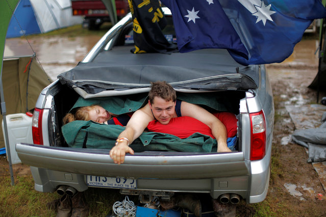 Australian couple Darren McGarvie, 27, and Nicole York, 24, wake up after spending the night together in McGarvie's Holden Commodore Ute at the Deni Ute Muster in Deniliquin, New South Wales, Australia, October 1, 2016. (Photo by Jason Reed/Reuters)