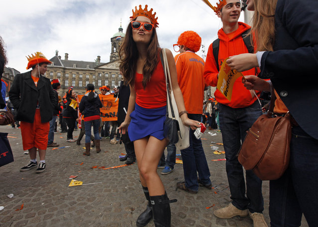 A woman celebrates the new Dutch King Willem-Alexander succeeds his mother Queen Beatrix, in Amsterdam's Dam Square, on April 30, 2013. (Photo by Cris Toala Olivares/Reuters)