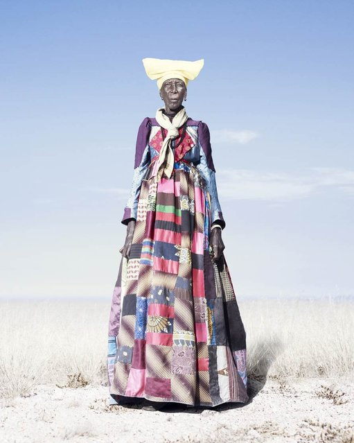 """An elderly Herero woman in patchwork dress and pale scarf, 2012. As Herero women get older, the """"horns"""" of their headdresses get smaller. According to some accounts, this is to symbolize their loss of fertility. (Photo by Jim Naughten, courtesy of Klompching Gallery, New York)"""