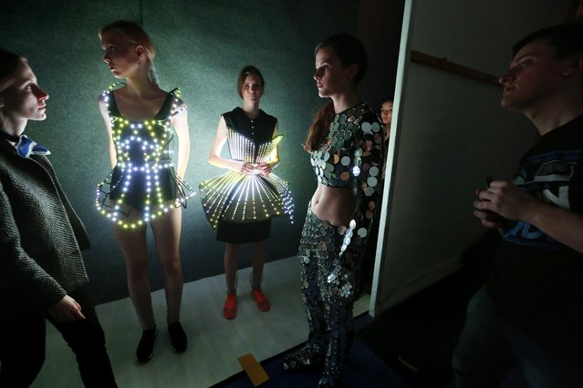 Models prepare backstage before presenting creations of Belarussian designer Tatyana Efremova during the Belarus Fashion Week in Minsk, Belarus, 14 April 2018. (Photo by Tatyana Zenkovich/EPA/EFE)