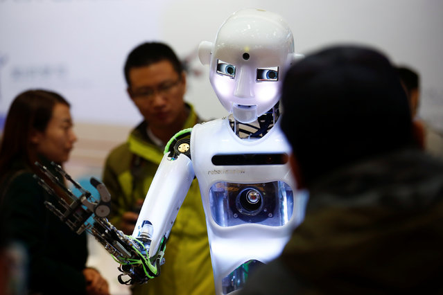 People look at a RoboThespian humanoid robot at the Tami Intelligence Technology stall at the WRC 2016 World Robot Conference in Beijing, China, October 21, 2016. (Photo by Thomas Peter/Reuters)