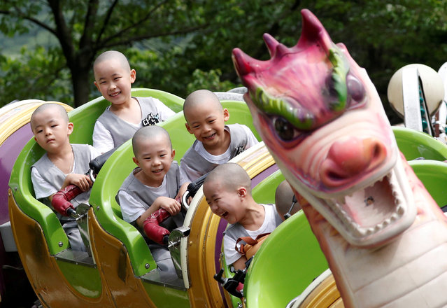 Boys, who are experiencing the lives of Buddhist monks by staying in a temple for two weeks as novice monks, enjoy a ride at the Everland amusement park in Yongin, South Korea, May 15, 2018. (Photo by Kim Hong-Ji/Reuters)