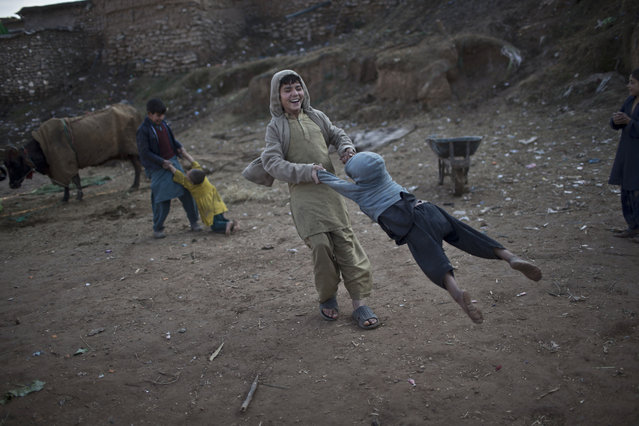 Afghan refugee children play in a slum on the outskirts of Islamabad, Pakistan, Wednesday, January 14, 2015. (Photo by Muhammed Muheisen/AP Photo)
