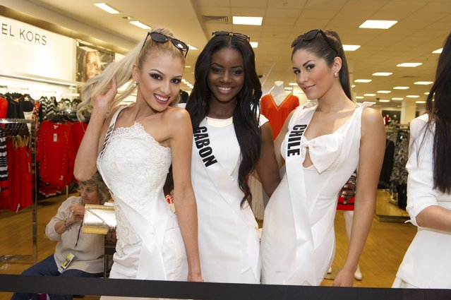 Miss Honduras 2014 Gabriela Ordonez (L-R), Miss Gabon 2014 Maggaly Nguema and Miss Chile 2014 Hellen Toncio pose for the Chinese Laundry shoes meet-and-greet at Macy's in Miami International Mall in this January 10, 2015 picture provided by the Miss Universe Organization. (Photo by Reuters/Miss Universe Organization)