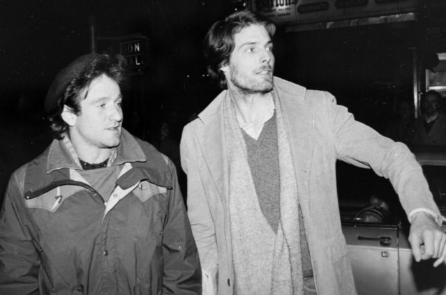 "Robin Williams, left, and Christopher Reeve, attempt to hail a taxicab in New York City on February 9, 1981.  Williams went to see Reeve, who is appearing in the play ""The Fifth of July"", backstage after his performance Friday night. (Photo by Steve Sands/AP Photo)"