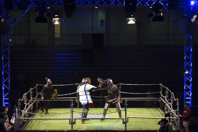 """An Israeli competitor (L) fights an Estonian competitor during the """"World Medieval Fighting Championship – the Israeli Challenge"""" in Rishon Letzion near Tel Aviv on January 22, 2015. (Photo by Amir Cohen/Reuters)"""