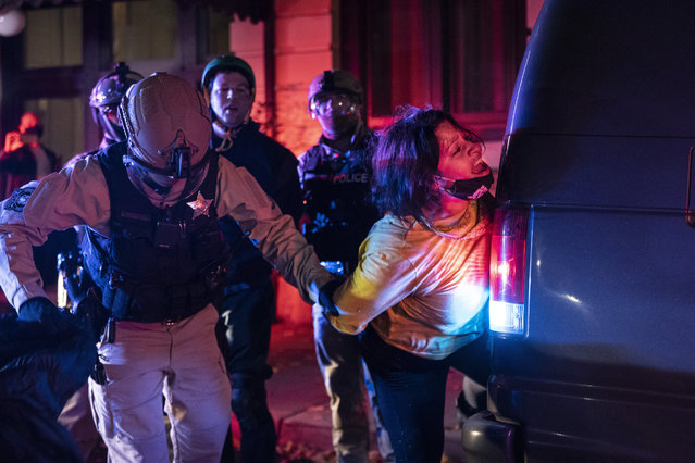Police arrest a protester as clashes during a march following the presidential election Wednesday, November 4, 2020, in Portland, Ore. (Photo by Paula Bronstein/AP Photo)