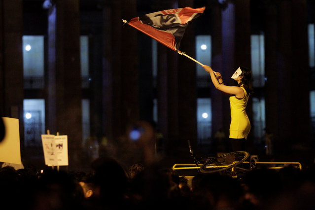 A woman waves a flag as she takes part in a protest against the killing of social activists, in Bogota, Colombia July 6, 2018. (Photo by Luisa Gonzalez/Reuters)