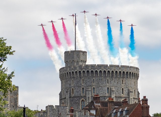 The Red Arrows fly over Windsor Castle as the RAF mark their 100th anniversary, July 10 2018. (Photo by Phil Donnelly/South West News Service)