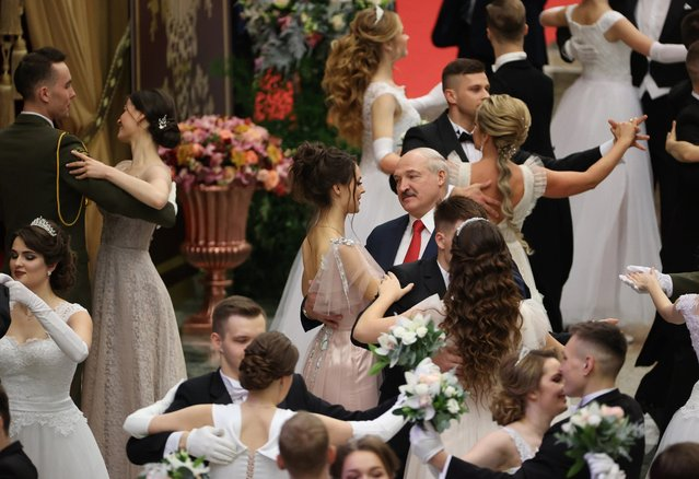 A photograph made available on 30 December 2020 shows Belarusian President Alexander Lukashenko (C) dancing with a young woman at a New Year's ball for youth in Minsk, Belarus, 29 December 2020. (Photo by Maxim Guchek/EPA/EFE)
