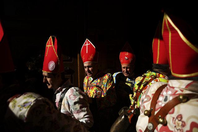 "Members of the Endiablada brotherhood leave the church during the ""Endiablada"" traditional festival in Almonacid Del Marquesado, Spain, Tuesday, February 3, 2015. (Photo by Daniel Ochoa de Olza/AP Photo)"