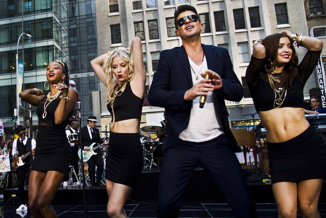 """Robin Thicke performs on NBC's """"Today"""" show in New York, on July 30, 2013. (Photo by Charles Sykes/Invision)"""