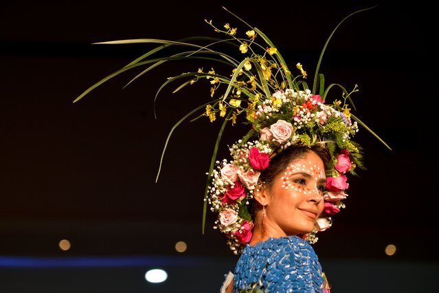 A model presents a creation by Colombian designer Jazmin Restrepo made with organic elements during BioFashion Show, on November 19, 2016, in Cali, Valle del Cauca department, Colombia. (Photo by Luis Robayo/AFP Photo)