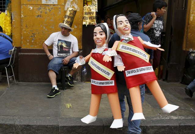 A man sells effigies of first lady Nadine Heredia in a market in Lima, Peru, December 30, 2015. (Photo by Mariana Bazo/Reuters)