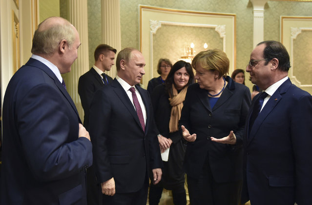 Russia's President Vladimir Putin (2nd L), Germany's Chancellor Angela Merkel (2nd R) and France's President Francois Hollande (R) attend a meeting on resolving the Ukrainian crisis, with Belarus' President Alexander Lukashenko (L) seen nearby, in Minsk, February 11, 2015. (Photo by Mykola Lazarenko/Reuters)