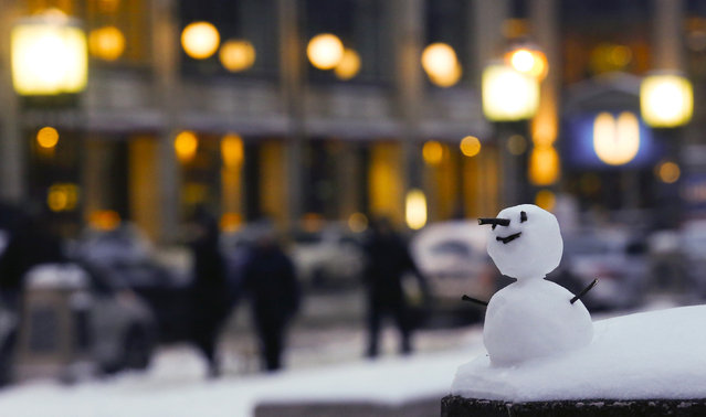 A little snowman stands at the Gendarmenmarkt square after snow falls in Berlin, Germany, January 7, 2016. (Photo by Hannibal Hanschke/Reuters)
