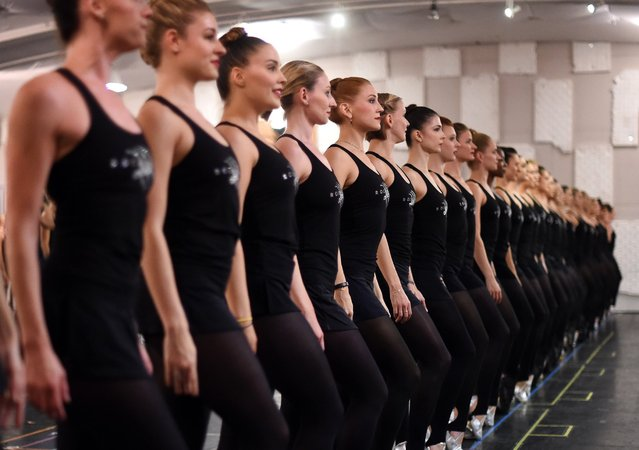 """The Rockettes rehearse for their 2015 production of Radio City Christmas Spectacular titled """"New York at Christmas"""" during a press preview at St. Paul the Apostle Church on October 15, 2015, in New York City. (Photo by Timothy A. Clary/Getty Images)"""