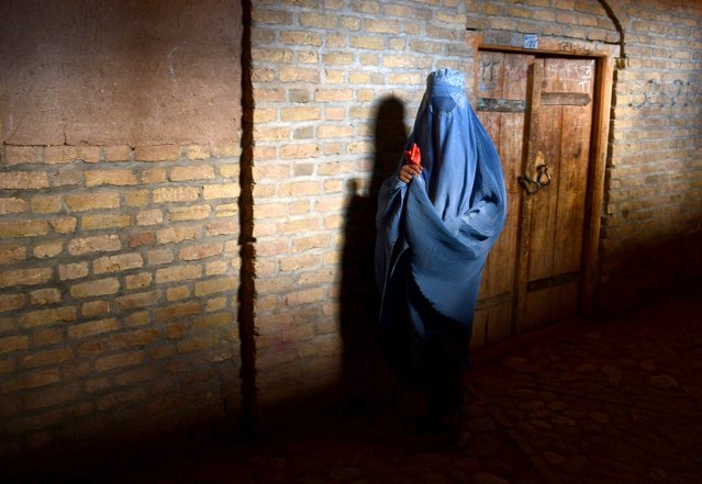 A burqa-clad Afghan woman walks in the old quarters of Herat, Afghanistan, November 16, 2016. (Photo by Aref Karmi/AFP Photo)