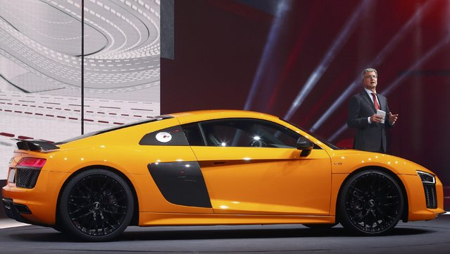 Audi CEO Rupert Stadler speaks next to the new Audi R8 V10 plus car during a Volkswagen Group event ahead of the 85th International Motor Show in Geneva, March 2, 2015.                 REUTERS/Arnd Wiegmann (SWITZERLAND  - Tags: TRANSPORT BUSINESS)