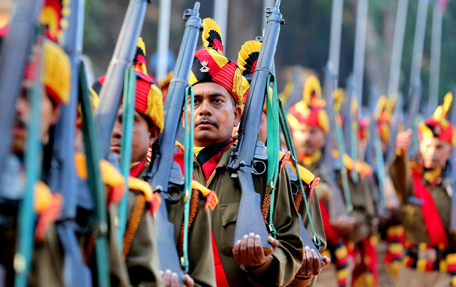 Indian state of Madhya Pradesh police Home Guards and civil defense contigents take part in a parade held to mark the 70th anniversary of the Home Guards' founding in Bhopal, India, 06 December 2016. The Home Guards is an Indian paramilitary voluntary force, which serve as an auxiliary to the police and assist in maintaining internal security and the community in any kind of emergency in air raids, fire, floods, and epidemics, natural disaster and other calamities. (Photo by Sanjeev Gupta/EPA)