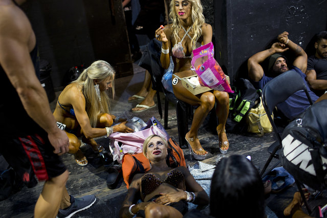 In this Thursday, October 18, 2018 photo, contestants wait for their performance backstage during the National Amateur Body Builders' Association competition in Tel Aviv, Israel. (Photo by Oded Balilty/AP Photo)