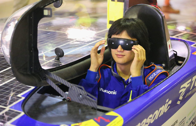 Kohhei Sagawa, a driver of the Tokai Challenger from Tokai University in Japan wears glasses as the solar car is height tested as cars are presented to the scrutineers for inspection and confirmation of their regulatory compliance and structural integrity on October 2, 2013 in Darwin, Australia. (Photo by Scott Barbour/Getty Images for the World Solar Challenge)