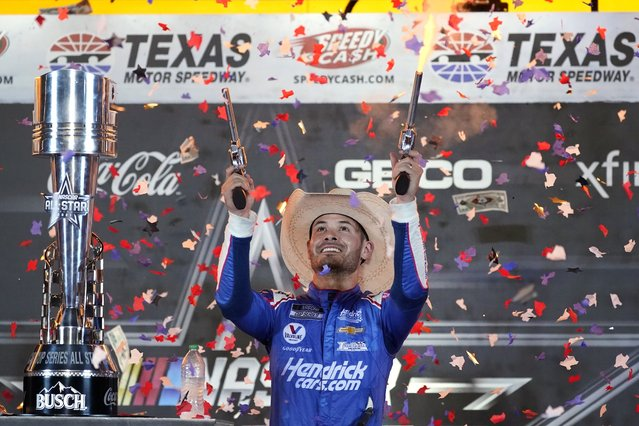 Kyle Larson celebrates in Victory Lane after winning the NASCAR Cup Series All-Star auto race at Texas Motor Speedway in Fort Worth, Texas, Sunday, June 13, 2021. (Photo by Tony Gutierrez/AP Photo)