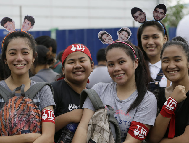 Filipino fans line up for the One Direction concert Saturday, March 21, 2015 in the suburban Pasay city south of Manila, Philippines. (Photo by Bullit Marquez/AP Photo)